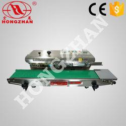 Hongzhan CBS-900/980/1100 plastic film aluminum foil sealing Continuous heat sealer for bag with date printing