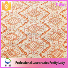 Wholesale white delicate flowering white poly dry lace fabric for cloth
