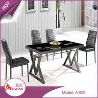Wholesale modern luxury black retractable lacquer tempered glass top dining table sets with 4 leather chairs