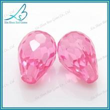 Loose pink glass teardrop shaped beads