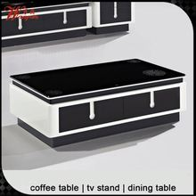 Black glass top wood coffee table with drawers
