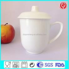 white porcelain coffee mug with lid