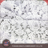 Wholesale custom promotional 100% polyester plain colors fashion pure white guipure cord lace fabric