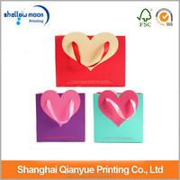 OEM production cutomized wedding paper bag .