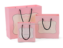 High quality custom pink stripes deigns shopping paper bag with black handle