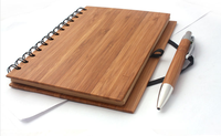 recycled paper spiral notebook with pen