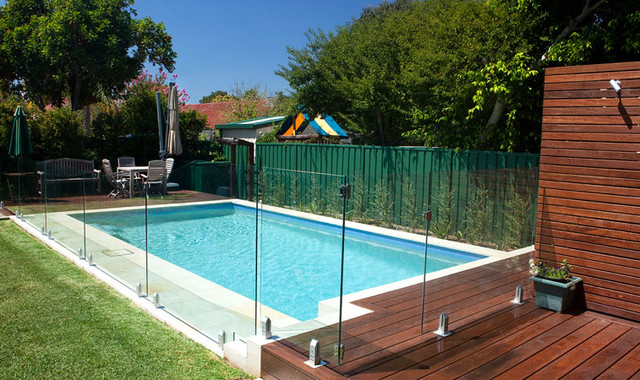 Decorative frameless curved glass panels balustrade view for Designer glass pool fencing