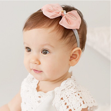 Trade new baby girl baby pearl bow headband hair accessories