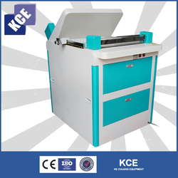 Small photo book making machine after printing