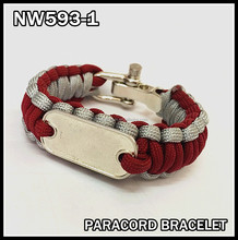Hands-made survival paracord bracelet with a stainless steel tag