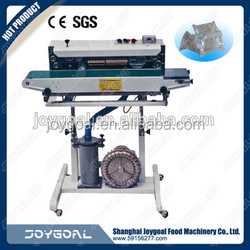 vertical band sealer with cup filler