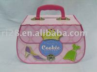 handbag shaped tin case with plastic handle and metal lock catch