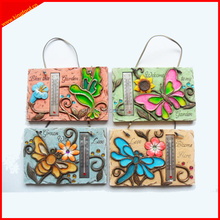 Decorative outdoor wall hanging plaque with thermometer functions