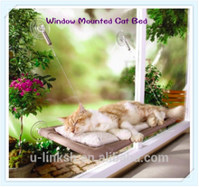 Cat hanging bed on the window
