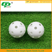 Small white plastic practice ball