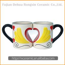 Wing to wing design heart shape decoration ceramic mug
