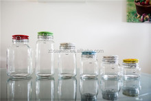 Square clear glass storage jar with colored ceramic clip lid with decal