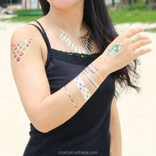Temporary tattoo sticker party on the beach