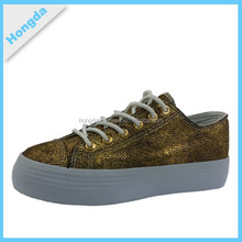 Fabric upper and rubber outsole casual shoes with golden color