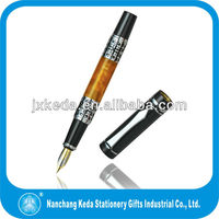 New stylish engraved/embossed pattern metal acrylic roller pen, orange pens