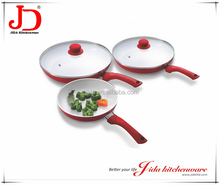 Induction bottom non stick frying pan with lid, white ceramic coating.
