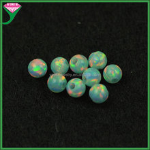 wholesale round drilled hole green fire synthetic opal stone beads price