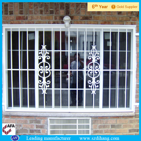 Wrought iron window grill design decorative wrought iron for Fancy window design