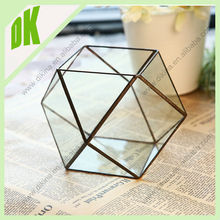 patterns may be very similar and/or repeated// open geometric glass set top box stand