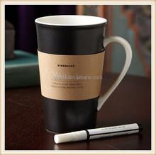 porcelain black mug with writing pen