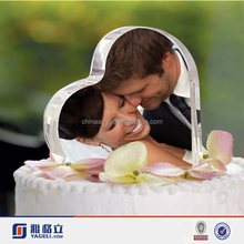 Heart shaped acrylic wedding cake topper with photo to show your love