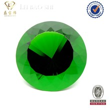 Round brilliant cut pointed back green glass stone