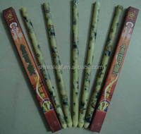 ear coning or thermal-auricular therapy beewax ear candles