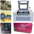 cortador láser y máquina grabadora para hacer arte en madera y la artesanía