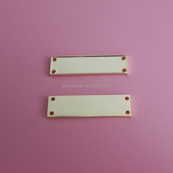 shiny gold blank metal plate with sew holes for clothing