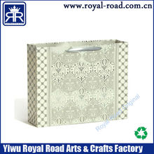 The decorative pattern of classical paper shopping bag luxury handbag