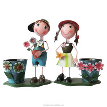 For garden decoration Metal crafts boy and girl with pot art and craft metal dolls