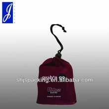 Folding nylon shopping bag with thumb stop