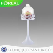 White mini cake stand with dome
