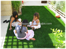 Synthetic artificial grass play surfaces for young children