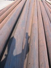 impregnated wooden poles, coal tar oil impregnation or with copper based wood preservatives