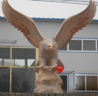 large outdoor stone eagle sculpture