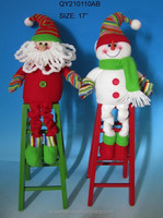 Christmas decorations santa snowman sit on ladder