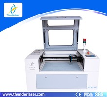 MINI laser paper cutter machine can make various patterns on phone with 600*400mm working area