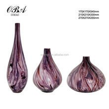 Tree pattern of the purple circular glass vases