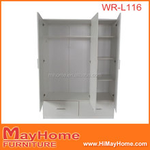 White big wooden wardrobe with drawers and shelves