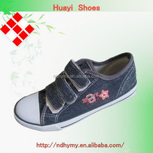 China latest kids casual velcro slip on buckle strap canvas shoes