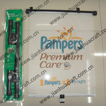 Rolling sunshades for auto with pampers logo