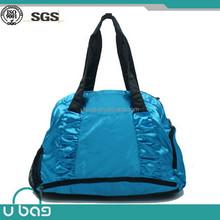 Light blue nylon shoe pocket inside sports duffle bag