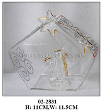 transparent glass open ball with pattern and nativity statue