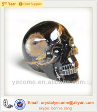 Natural iron Huang Hu tiger eye stone skull carving furnishing articles a handicraft collection in hand